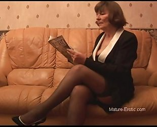 Puristic granny upon nylons plays with panties then undresses