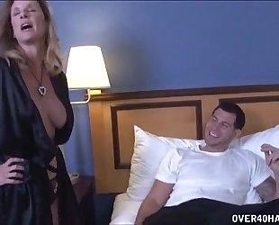 Sexy milf strokes a juvenile wang