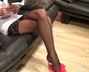 Tall woman stockinged lengthy legs and extreme hig...