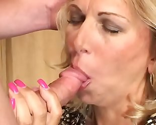 Sexy ass milf blonde Debbie Lien gets her pussy fucked hardcore and enjoys it on the sofa
