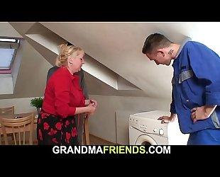 Two workers screw busty blonde grandma