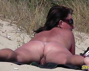 Amateur nudist voyeur bulky milf close-up movie scene