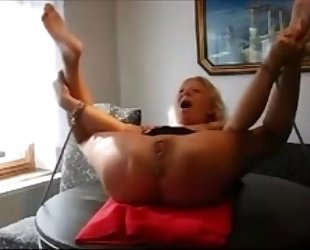 Mature thrall fastened to a table and fisted