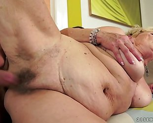 Granny's hair pussy overspread with cum