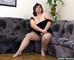 Busty and aged bbw masturbates with dildo