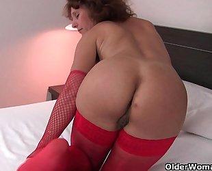 Hot granny in nylons rubs her bushy slit