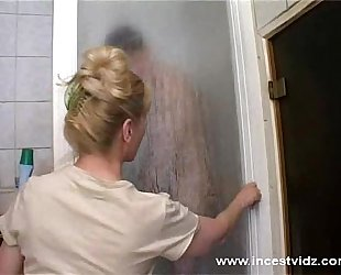 Mature mamma and her son on the shower
