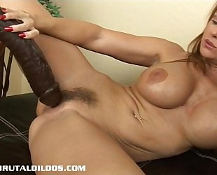 Busty milf janet taking each foot of a large brutal fake penis