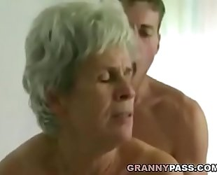 Young guy copulates shaggy granny