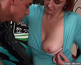 Cum hungry grandma helga takes a fist and a facial