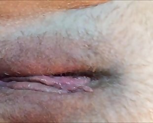 Wet vagina agonorgasmos closeup with contractions
