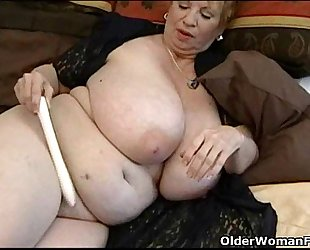Fat granny dagny with her large milk cans plays with sex toy