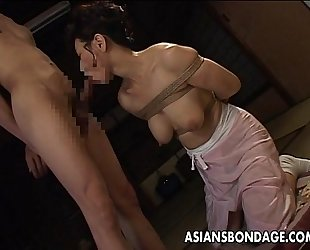 Bound japanese milf sucks on a hard penis