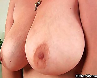 Hairy grandma with large bumpers has solo sex with a fake penis